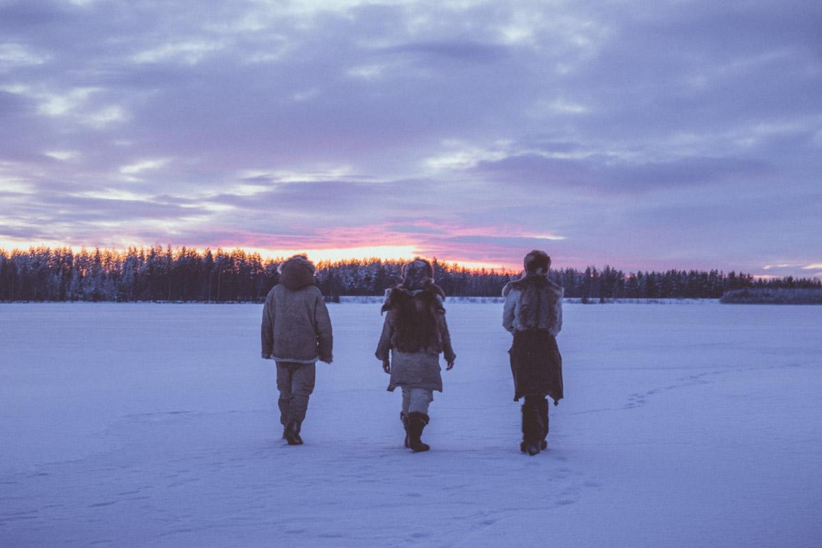 Stone age people walking over frozen river in Kierikki, Yli-Ii