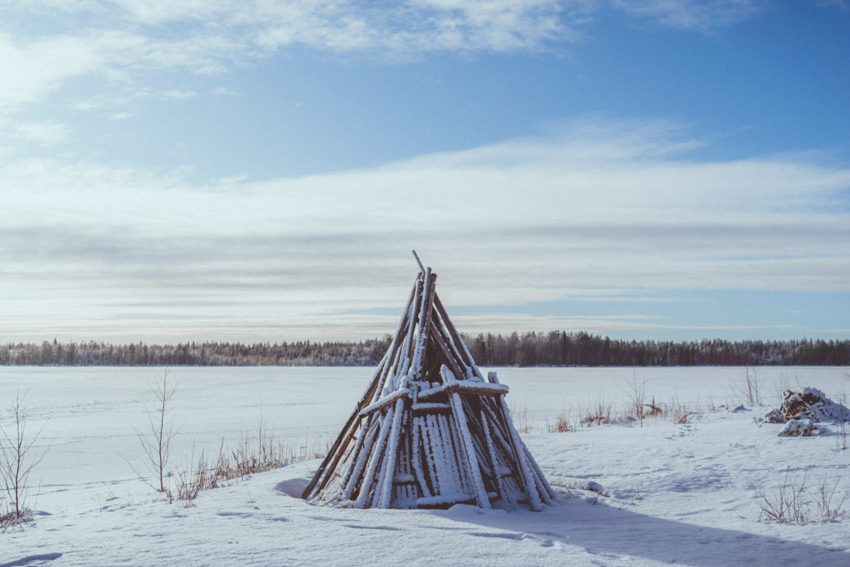 Wooden structure covered in snow