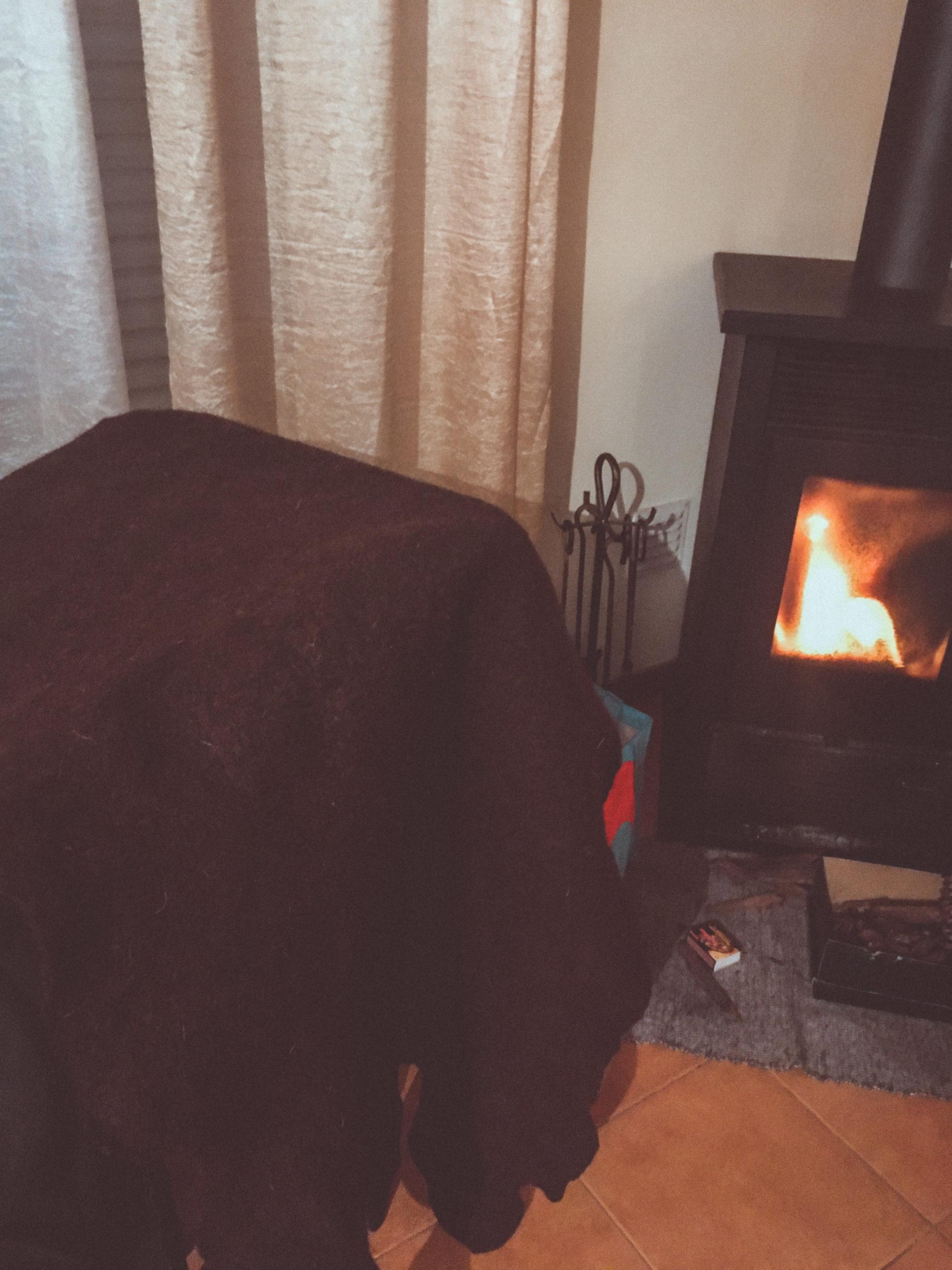 felt blanket by fireplace